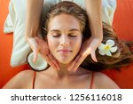 ayurvedic relaxing massage ... | Shutterstock . vector #1256116018