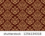 Wallpaper in the style of Baroque. Seamless background. Gold and dark brown floral ornament. Graphic pattern for fabric, wallpaper, packaging. Ornate Damask flower ornament - stock photo