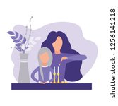 mother and daughter lighting... | Shutterstock .eps vector #1256141218