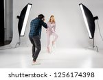 back view of photographer... | Shutterstock . vector #1256174398