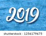 happy new year 2019. paper 3d... | Shutterstock . vector #1256179675