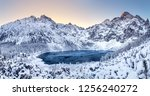 winter dawn in mountains.... | Shutterstock . vector #1256240272