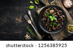 fried mushrooms with parsley on ... | Shutterstock . vector #1256385925