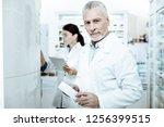 ready to work. kind senior... | Shutterstock . vector #1256399515