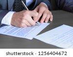 close up.businessman filling... | Shutterstock . vector #1256404672