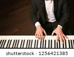 hands on piano. the pianist... | Shutterstock . vector #1256421385