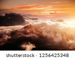 thick fog covered the ridge in... | Shutterstock . vector #1256425348
