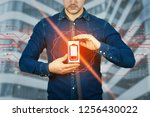 serious casual man holding...   Shutterstock . vector #1256430022