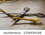 Small photo of Internet ban, cencorship and interruption. Yellow Internet cable cut by scissors.