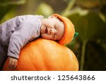 Baby Sleeping On Big Pumpkin