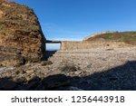 dyke bridge in ruins towards an ...   Shutterstock . vector #1256443918