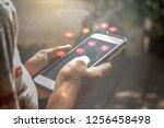 young women using smart social... | Shutterstock . vector #1256458498