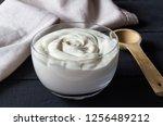 yogurt in glass bowl with... | Shutterstock . vector #1256489212