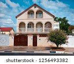 light brick two storey house...   Shutterstock . vector #1256493382