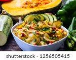 braised sliced zucchini | Shutterstock . vector #1256505415