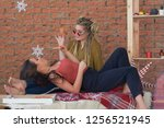 two girls eat pizza in the room ... | Shutterstock . vector #1256521945