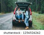 couple stop to drink hot tea....   Shutterstock . vector #1256526262