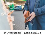 car at gas station. gasoline... | Shutterstock . vector #1256530135