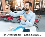 businessman taking selfie | Shutterstock . vector #1256535082