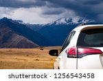 white car back view on... | Shutterstock . vector #1256543458