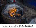 stove charcoal.orange flames of ... | Shutterstock . vector #1256548462