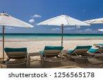 sunbeds and umbrellas on a...   Shutterstock . vector #1256565178