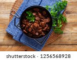 jug of goulash beef stew with... | Shutterstock . vector #1256568928
