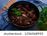 jug of goulash beef stew with... | Shutterstock . vector #1256568955