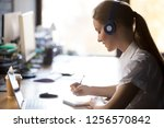 focused woman wearing... | Shutterstock . vector #1256570842