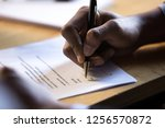 male african hand signing... | Shutterstock . vector #1256570872