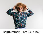adult shylish funky man in... | Shutterstock . vector #1256576452