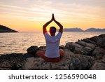 male traveler practice yoga on...   Shutterstock . vector #1256590048