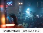 young people in tattoo studio.... | Shutterstock . vector #1256616112