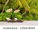 wooden sunbed on tropical beach ...   Shutterstock . vector #1256618365