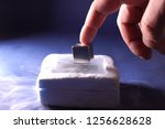 cube levitation on a magnetic... | Shutterstock . vector #1256628628