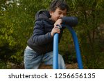 boy play in the nature | Shutterstock . vector #1256656135