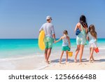 family of four on the beach on... | Shutterstock . vector #1256666488