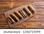 french dessert eclair with... | Shutterstock . vector #1256715595