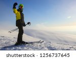 skier on ski slope with... | Shutterstock . vector #1256737645