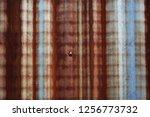 a rusty steel sheet texture.... | Shutterstock . vector #1256773732