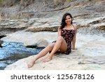 young hispanic woman near a... | Shutterstock . vector #125678126