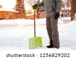 man shoveling and removing snow ... | Shutterstock . vector #1256829202