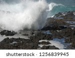 Small photo of Wave at the coast of lava stones north west of Gran Canaria