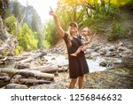 beautiful young mother and her... | Shutterstock . vector #1256846632