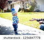 cute smiling little boy walking ... | Shutterstock . vector #1256847778
