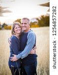 a beautiful middle aged couple... | Shutterstock . vector #1256857282