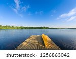yellow canoe sitting on a lake... | Shutterstock . vector #1256863042
