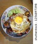 rice and stir fried crispy pork ... | Shutterstock . vector #1256897398
