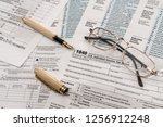 1040 tax form with pen and... | Shutterstock . vector #1256912248