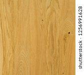 a fragment of a wooden panel...   Shutterstock . vector #1256991628